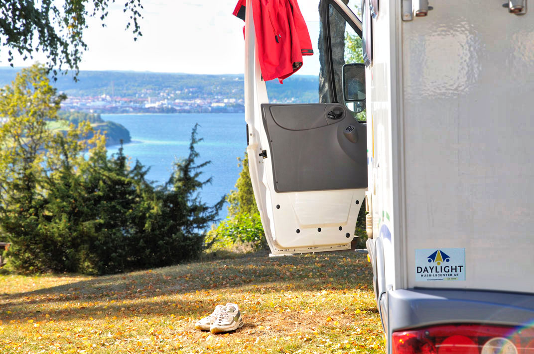 Park motorhome with lake view at outdoor resort IKPH
